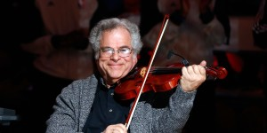 NEW YORK, NY - JANUARY 28: (NEW YORK DAILIES OUT) Violinist Itzhak Perlman performs before the NBA game between the Brooklyn Nets and Orlando Magic at the Barclays Center on January 28 , 2013 in the Brooklyn borough of New York City.The Nets defeated the Magic 97-77. NOTE TO USER: User expressly acknowledges and agrees that, by downloading and/or using this Photograph, user is consenting to the terms and conditions of the Getty Images License Agreement. (Photo by Jim McIsaac/Getty Images)